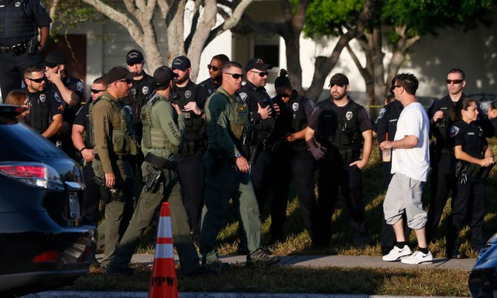 Marjory Stoneman Douglas High School staff, teachers and students return to school greeted by police and well wishers in Parkland, Florida on February 28, 2018. (RHONA WISE/AFP/Getty Images)