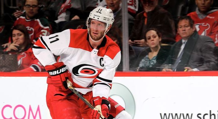 Jordan Staal No. 11 of the Carolina Hurricanes takes the puck against the New Jersey Devils on Feb. 15, 2018, at Prudential Center in Newark, N.J.The New Jersey Devils defeated the Carolina Hurricanes 5-2.  (Elsa/Getty Images)