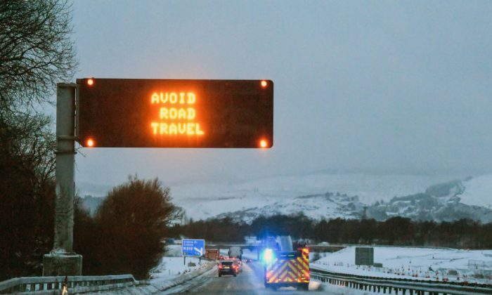 A road warning sign advising not to travel on the M8 on Feb. 28, in Glasgow, Scotland. (Jeff J Mitchell/Getty Images)