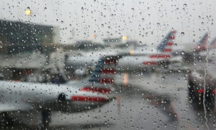 Airplanes are seen parked through a rain soaked window at their gates during a winter nor'easter at LaGuardia Airport in New York, March 2, 2018. (Shannon Stapleton/Reuters)