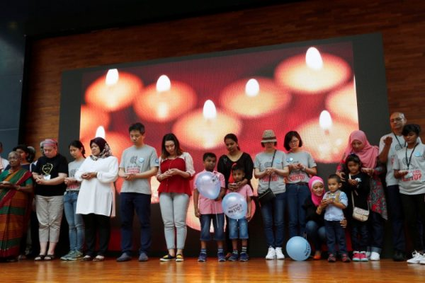 Families hold candles during fourth annual remembrance event for missing MH370, in Kuala Lumpur