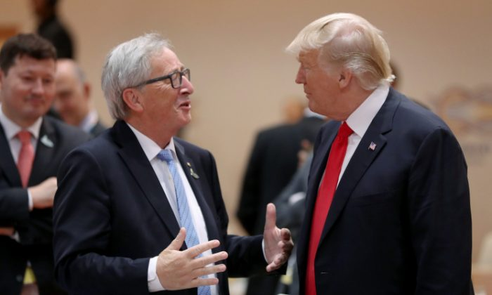 U.S. President Donald Trump (R) and President of the European Commission Jean-Claude Juncker chat prior to the morning working session on the second day of the G20 economic summit in Hamburg, Germany on July 8, 2017. (Sean Gallup/Getty Images)