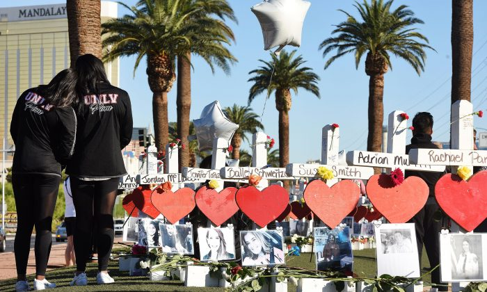 Members of the University of Las Vegas pom squad visit 58 white crosses for the victims of the Oct. 1, 2017, mass shooting on the Las Vegas Strip just south of the Mandalay Bay hotel, Oct. 6, 2017. (Robyn Beck/AFP/Getty Images)