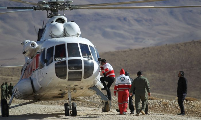 FILE PHOTO:Members of emergency and rescue team search for the plane that crashed in a mountainous area of central Iran, Feb. 19, 2018. (Reuters/Tasnim News Agency)