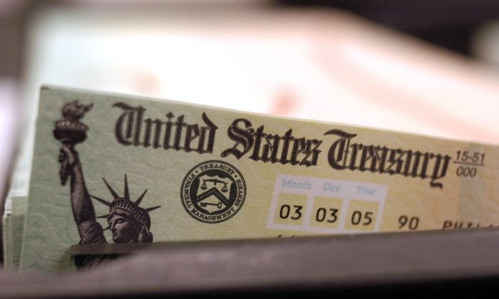 Blank Social Security checks are run through a printer at the U.S. Treasury printing facility in Philadelphia, Pennsylvania, on Feb. 11, 2005. (William Thomas Cain/Getty Images)