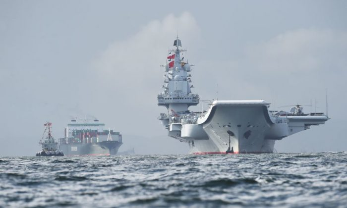 China's sole aircraft carrier, the Liaoning (R), arrives in Hong Kong waters on July 7, 2017.  (Anthony Wallace/AFP/Getty Images)