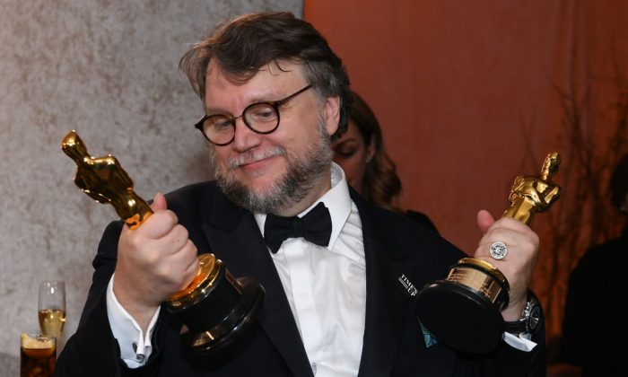 Best Director and Best Film laureate Mexican director Guillermo del Toro stands at the engraving station as he attends the 90th Annual Academy Awards Governors Ball at the Hollywood & Highland Center on March 4, 2018, in Hollywood, California. (Angela Weiss/AFP/Getty Images)