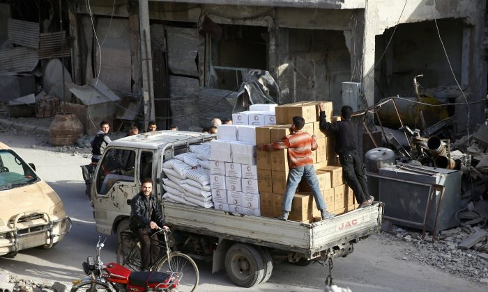 A pick-up truck loaded with humanitarian aid arrives at the besieged town of Douma, Eastern Ghouta, Damascus, Syria March 5, 2018. (Reuters/Bassam Khabieh)