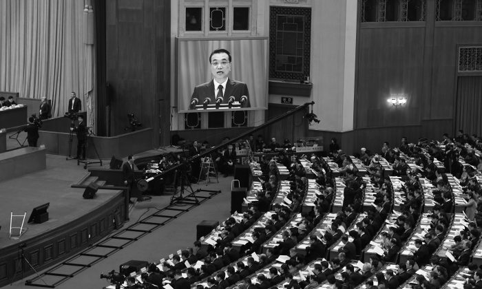 A live image of Chinese Premier Li Keqiang on a screen as he delivers his work report during the opening session of the National People's Congress in the Great Hall of the People in Beijing on March 5, 2018. (Greg Baker/AFP/Getty Images)