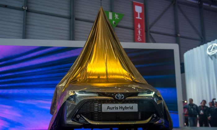A Toyota Auris Hybrid is  uncovered at the International Motor Show on March 6, 2018 in Geneva, Switzerland. One of the pioneers of hybrid technology cars, Toyota is better placed than many manufacturers as the market lurches away from diesels. (Robert Hradil/Getty Images)
