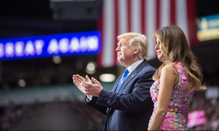 President Donald Trump with First Lady Melania Trump during the President's Make America Great Again Rally in Youngstown, Ohio, on July 25, 2017. (Benjamin Chasteen/The Epoch Times)