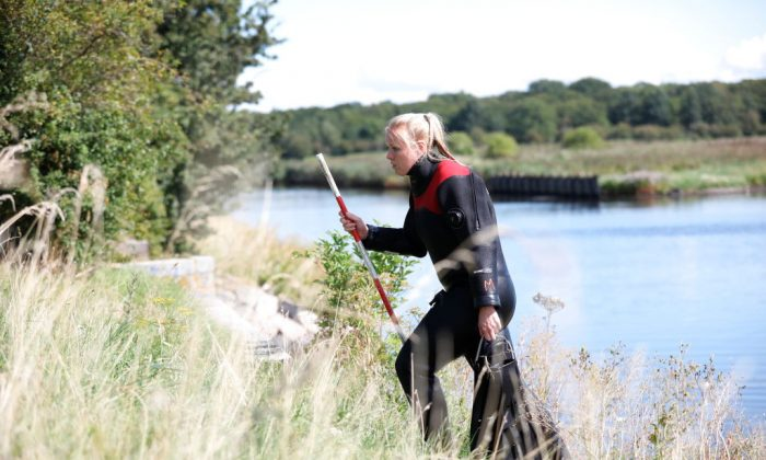 Members of The Danish Emergency Management Agency (DEMA) assist police at Kalvebod Faelled in Copenhagen on Aug. 23, 2017 in search of missing bodyparts of journalist Kim Wall close to the site where her torso was found on, Aug. 21. (MARTIN SYLVEST/AFP/Getty Images)