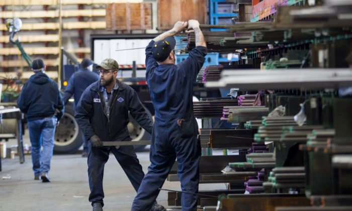 Laborers fill orders of machine grade steel to be shipped throughout the Pacific Northwest at the Pacific Machinery Tool Steel Companyin Portland, Oregon, on March 6, 2018. (Natalie Behring/Getty Images)