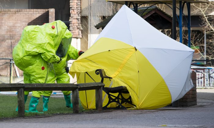 Specialist officers in protective suits secure the police forensic tent which is covering the bench where Sergei Skripal and his daughter were found critically ill on March 4 and were taken to hospital sparking a major incident in Salisbury Wiltshire, England on March 8, 2018. (Matt Cardy/Getty Images)