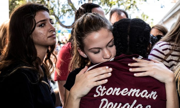 Students from Marjory Stoneman Douglas High School attend a memorial following a school shooting incident in Parkland, Florida, U.S., Feb. 15, 2018.  (Reuters/Thom Baur/File Photo)