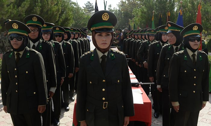 Newly-graduated female Afghan National Army (ANA) officers attend a graduation ceremony at the Afghan National Army training centre in Kabul on August 24, 2014. Afghan security forces are due to take over from their Western allies, a US-led NATO force, by the end of 2014 when the foreign troops leave the country. (SHAH MARAI/AFP/Getty Images)
