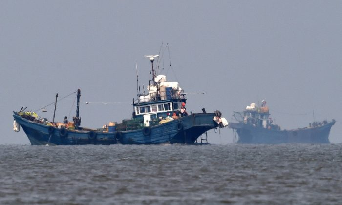 Illegal Chinese fishing boats are seen in neutral waters on June 10, 2016, in Ganghwa island, South Korea. South Korea sent military vessels on Friday to chase away about 10 illegal Chinese fishing boats in neutral water around South Korea's Ganghwa island, based on reports. (South Korean Defense Ministry via Getty Images)