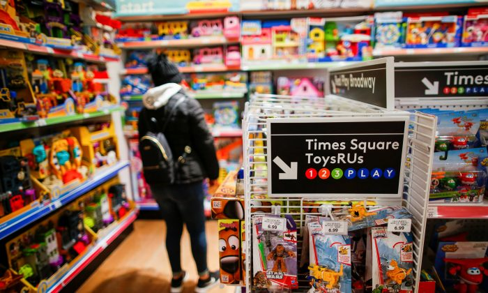 A woman visits a Toys R Us store at Times Square in New York, U.S., March 9, 2018. (Reuters/Eduardo Munoz)