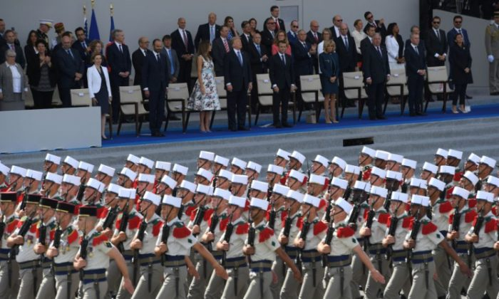(L-R) President Donald Trump and his wife First Lady Melania Trump, French President Emmanuel Macron and his wife watch the annual Bastille Day military parade on the Champs-Elysees avenue in Paris on July 14, 2017. (Christophe Archambault/AFP/Getty Images)