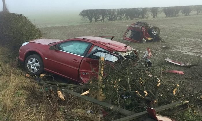 The aftermath of the crash in North Yorkshire left a car split in two in a field. (SWNS)