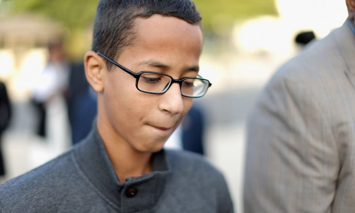 Fourteen-year-old Ahmed Mohamed (R) of Irving, Texas, arrives for a news conference outside the U.S. Capitol Oct. 20. (Chip Somodevilla/Getty Images)