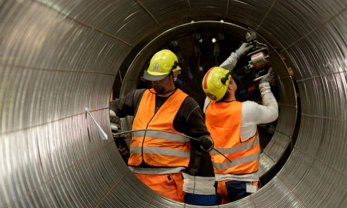 In this file photo, workers are working on a pipe in the production hall at the Nord Stream 2 facility in Sassnitz, Germany.  (Carsten Koall/Getty Images)