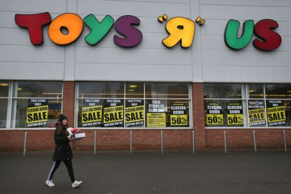 A customer walks out of a Toys r Us store