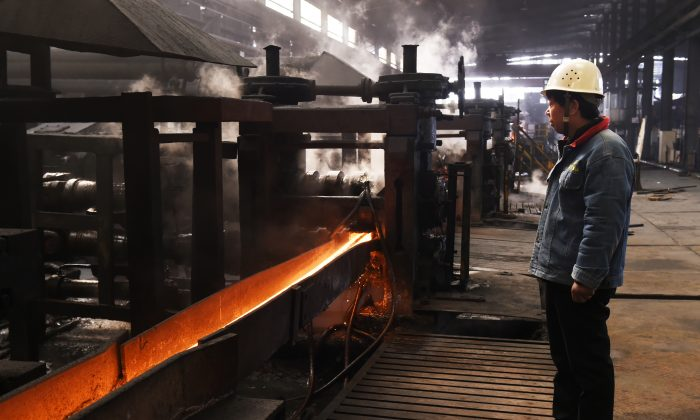 A worker stands in a steel workshop in Zouping, in China's eastern Shandong Province on March 10, 2018. The U.S. recently imposed tariffs on aluminum and steel imports. (AFP/Getty Images)