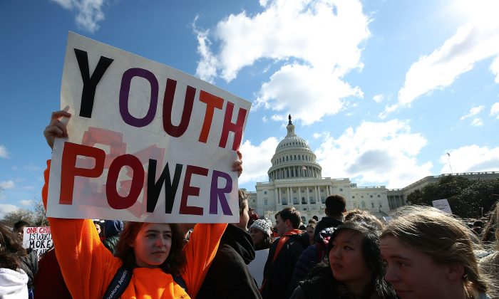 Seventeen-year-old Annie McCasland of Potomac, Maryland holds up a sign during a rally at the U.S. Capitol to urge Congress to take action against gun violence on March 14, 2018 on Capitol Hill in Washington, DC. The protest marked one month since a gunman killed 17 people at Marjory Stoneman Douglas High School in Parkland, Florida.  (Mark Wilson/Getty Images)