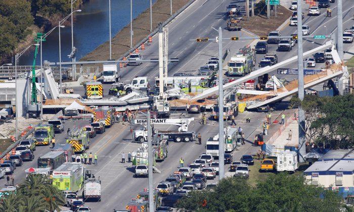 Aerial view shows a pedestrian bridge collapsed at Florida International University in Miami, Florida, U.S., March 15, 2018.  (REUTERS/Joe Skipper)