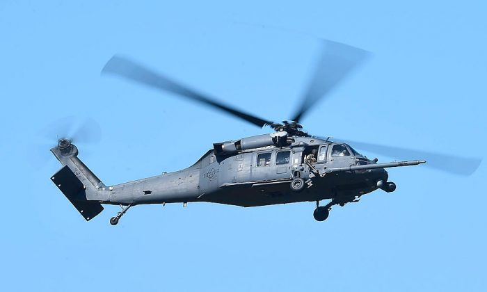A file photograph of a U.S. military HH-60 Pave Hawk Helicopter flying over Townsville, Australia,  July 1, 2016 .(Ian Hitchcock/Getty Images)