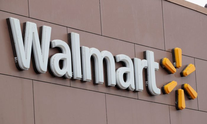 A sign hangs outside Walmart store in Chicago, Illinois, on Jan. 11, 2018. (Scott Olson/Getty Images)