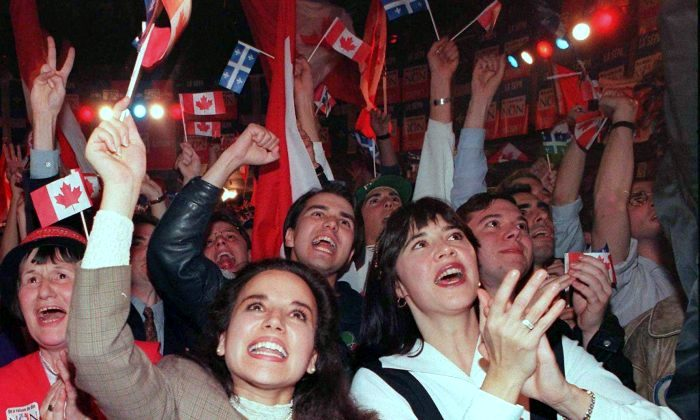 """""""No"""" supporters cheer as vote results come in on the Quebec independence referendum at campaign headquarters in Montreal on the night of Oct. 30, 1995. Bloc Quebecois founder Lucien Bouchard says he is """"very discouraged"""" by what he sees happening within the sovereigntist party. (The Canadian Press/Tom Hanson)"""