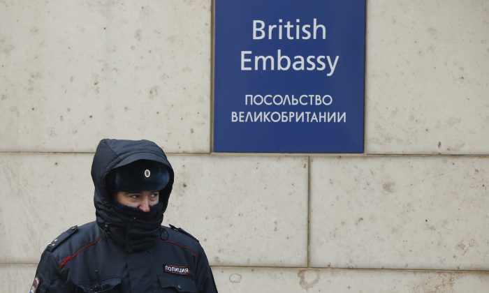 A Russian policeman walks outside the British embassy in Moscow, Russia, March 17, 2018. (Reuters/David Mdzinarishvili)