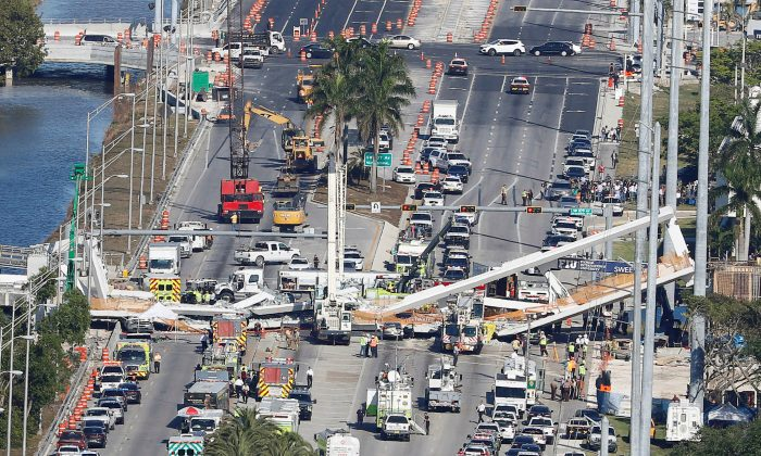 Aerial view shows a pedestrian bridge collapsed at Florida International University in Miami, Fla., on March 15, 2018.  (REUTERS/Joe Skipper/File Photo)