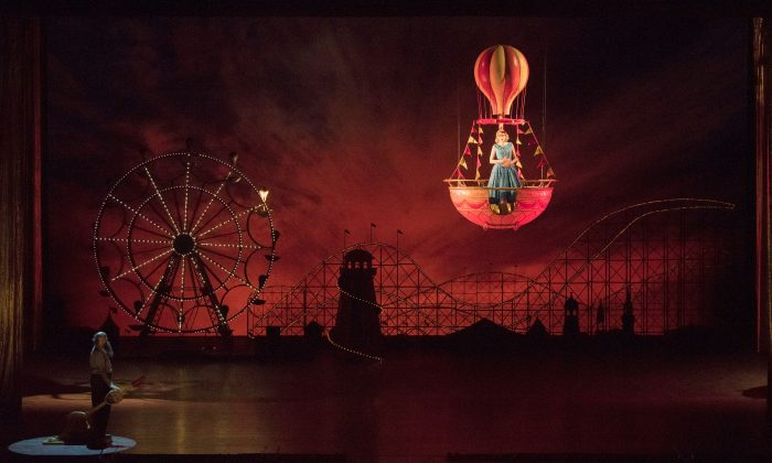 """A scene from Act II of Wolfgang Amadeus Mozart's """"Così fan tutte,"""" set at Coney Island in the 1950s.  (Jonathan Tichler/The Metropolitan Opera)"""