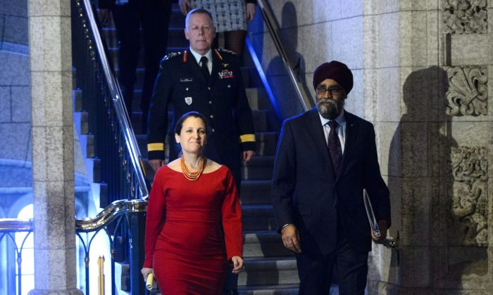 Minister of National Defence Minister Harjit Sajjan, Minister of Foreign Affairs Chrystia Freeland, and Chief of Defence Staff Jonathan Vance arrive to take part in a press conference on Canada's peacekeeping mission to Mali in the foyer of the House of Commons on March 19, 2018. (The Canadian Press/Sean Kilpatrick)