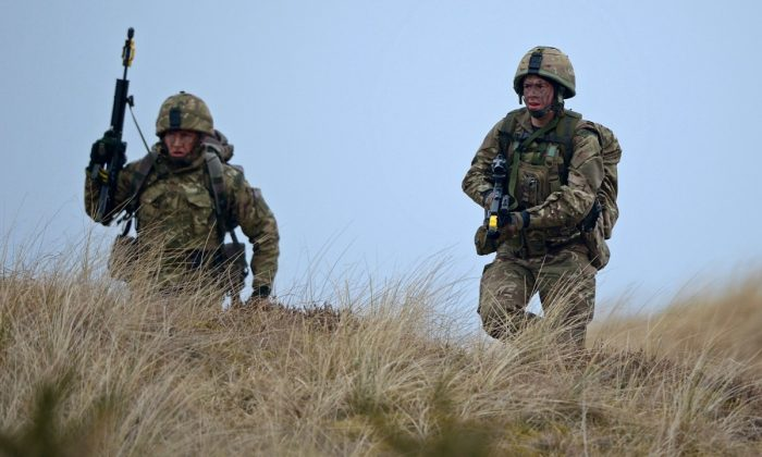 Royal Marines from 42 Commando take part in an exercise at Barry Buddon simulating an attack on shores of a hostile country in Carnoustie, Scotland on April 12, 2013.  (Photo by Jeff J Mitchell/Getty Images)