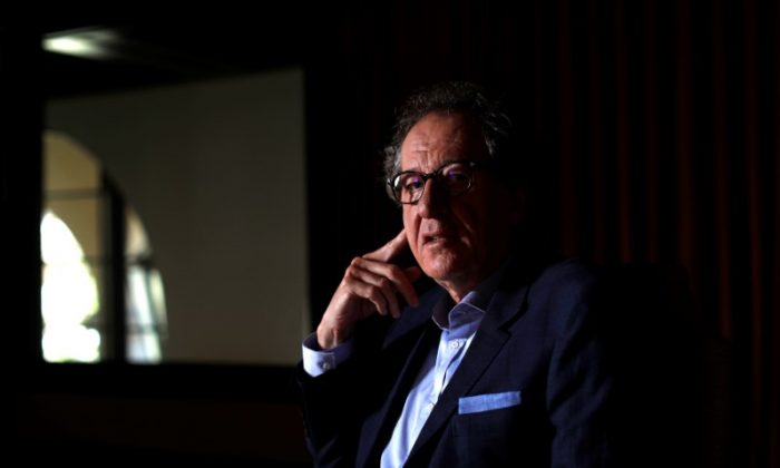 "Cast member Geoffrey Rush poses for a portrait while promoting the upcoming movie ""Pirates of the Caribbean: Dead Men Tell No Tales"" in Beverly Hills, California U.S., May 20, 2017.  (Reuters/Mario Anzuoni)"