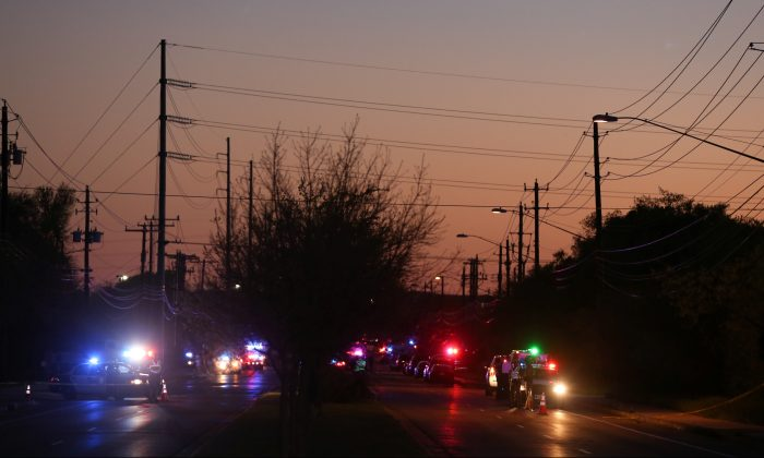 Law enforcement personnel investigate an incident that they said involved an incendiary device in the 9800 block of Brodie Lane in Austin, Texas, U.S., March 20, 2018. (Reuters/Loren Elliott)