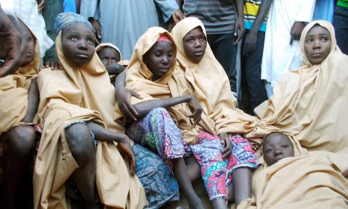 Some of the newly-released Dapchi schoolgirls are pictured in Jumbam village, Yobe State, Nigeria  March 21, 2018. (Reuters/Ola Lanre)
