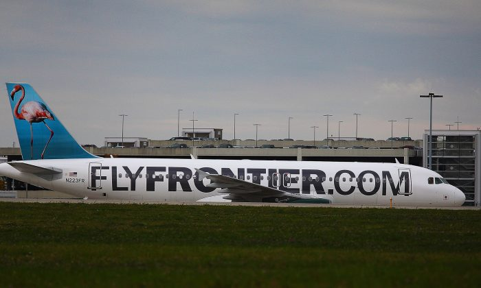 A Frontier Airlines plane taxis the runway at Cleveland Hopkins Airport on Oct. 15, 2014, in Cleveland, Ohio. (Michael Francis McElroy/Getty Images)