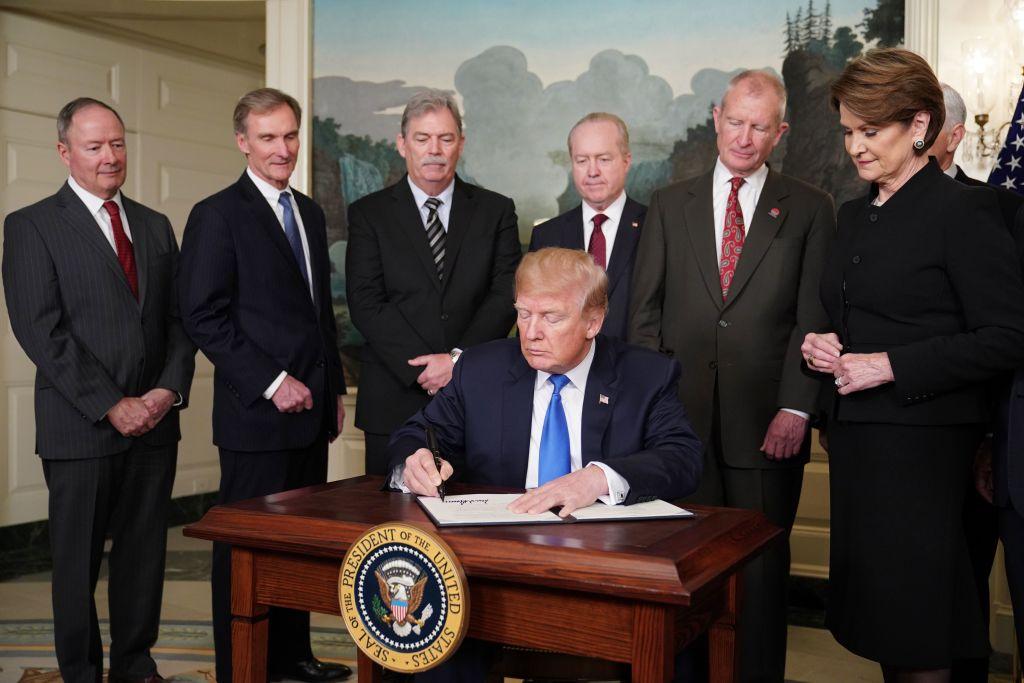 Trump signs tariffs