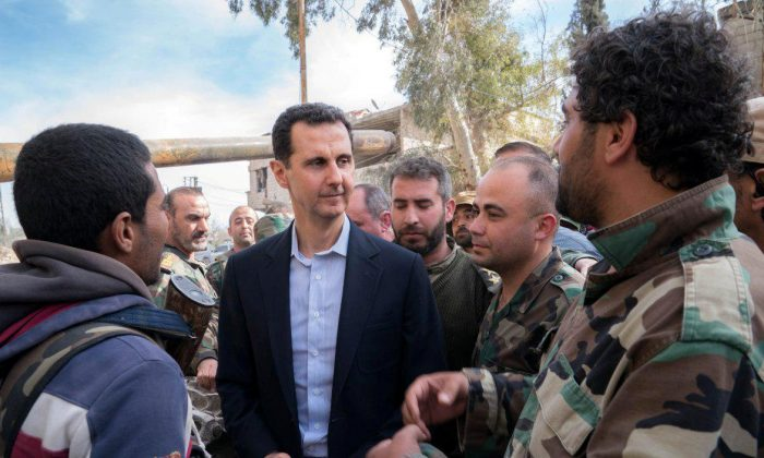 Syrian President Bashar al-Assad reported to be meeting with Syrian army soldiers in eastern Ghouta, Syria, March 18, 2018. (SANA/Handout via Reuters)