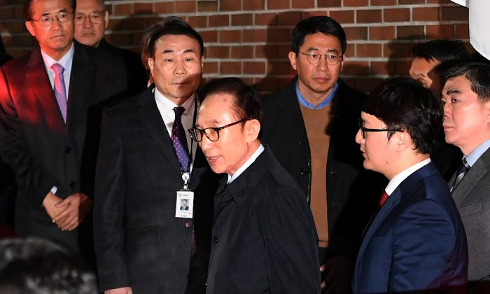 Former South Korean president Lee Myung-Bak gets in a car as he is transferred to a detention center, at his residence in Seoul as he is transferred to a detention center, at his residence in Seoul, South Korea March 23, 2018. (Jung Yeon-Je/Pool via Reuters)