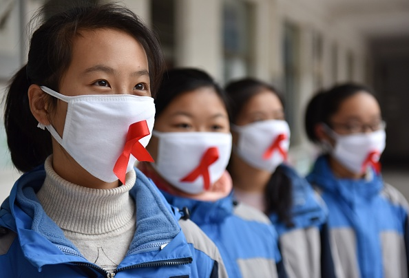 Students of Chaohu No.2 Middle School wear masks with red ribbons in Chaohu City, Anhui Province of China, on November 30, 2017.  (Photo by VCG/VCG via Getty Images)