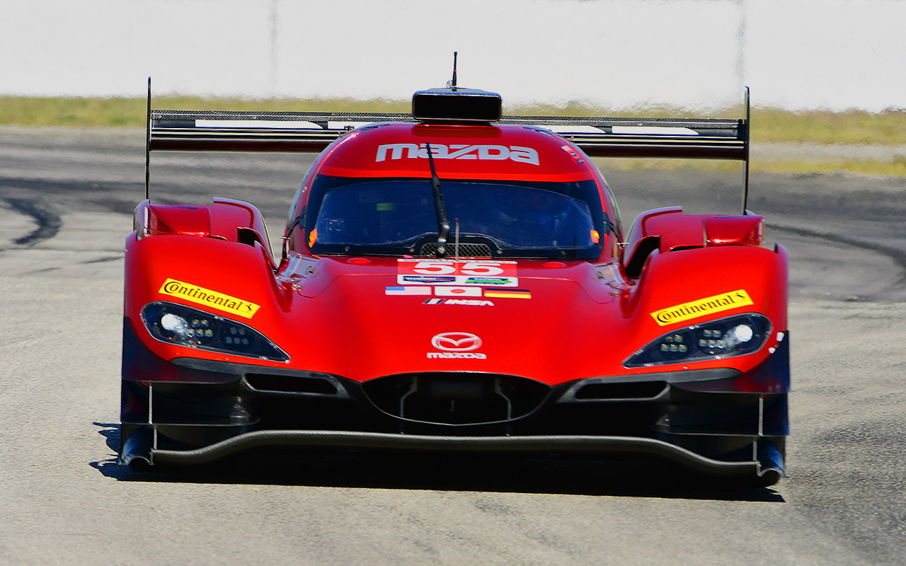 The Mazdas are arguably the prettiest cars on the grid—and at long last, are among the fastest. The #55 finished sixth, but it led laps on pace, showed good fuel efficiency, and barring a balky clutch would have been on some step of the podium. (Bill Kent/Epoch Times)