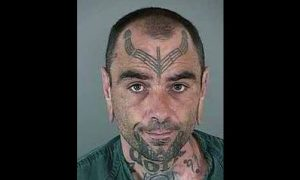FBI Seeking Help Finding Fugitive With 'Dork' Tattoo on His Neck