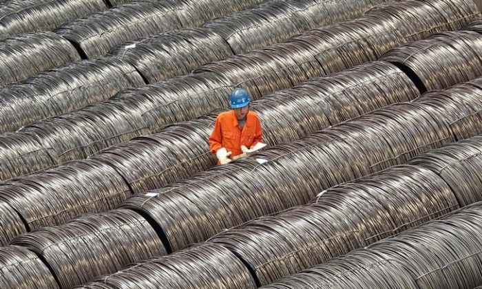 A worker checks steel wires at a warehouse in Dalian City, Liaoning Province of northern China, on May 15, 2017. (Stringer/Reuters)