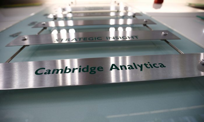 The nameplate of political consultancy, Cambridge Analytica, is seen in central London on March 21, 2018. (Reuters/Henry Nicholls)